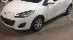 Mazda 2  / Model 2013 / White Car